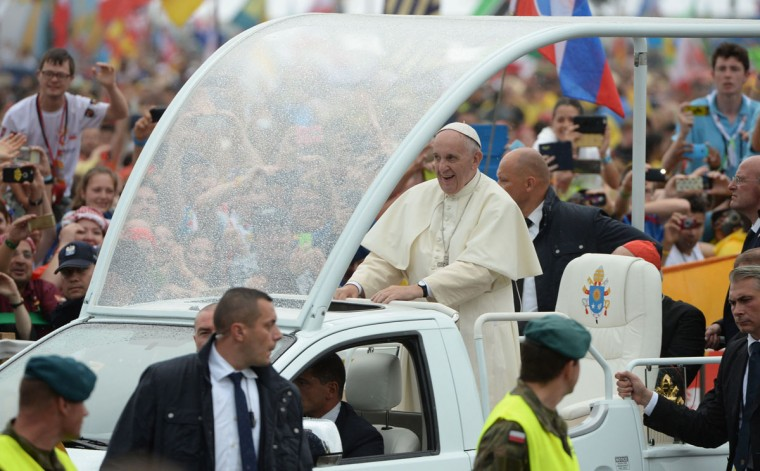 Pope Francis makes his way to Blonia Park in Krakow to open the World Youth Days. (FILIPPO MONTEFORTE/AFP/Getty Images)