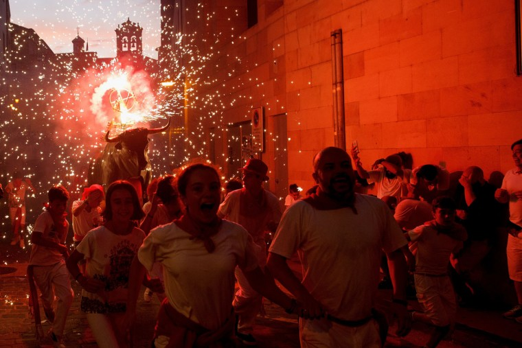 A Toro del Fuego (flaming bull) is run through the streets of Pamplona during the second day of the San Fermin Running of the Bulls festival on July 7, 2016 in Pamplona, Spain. The annual Fiesta de San Fermin, made famous by the 1926 novel of US writer Ernest Hemmingway entitled 'The Sun Also Rises', involves the daily running of the bulls through the historic heart of Pamplona to the bull ring. (Photo by Pablo Blazquez Dominguez/Getty Images)