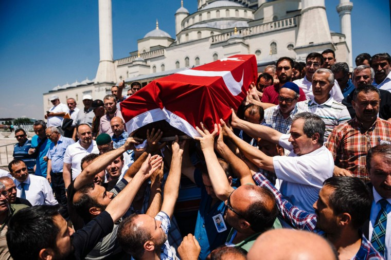 People carry the coffin of Sehidmiz Murat Inci, victim of the coup attempt during his funeral ceremony, at Kocatepe Mosque in Ankara on July 18, 2016. Support from the highest echelons in the army helped keep President Recep Tayyip Erdogan in power after the failed coup but July 15's events risk further undermining the military's status as a key player in Turkish politics. Turkey has detained 103 generals and admirals as well as more than 2,800 soldiers accused of supporting July 15's attempted power grab, but most of the military's senior figures stayed loyal to Erdogan. (AFP PHOTO / DIMITAR DILKOFF)