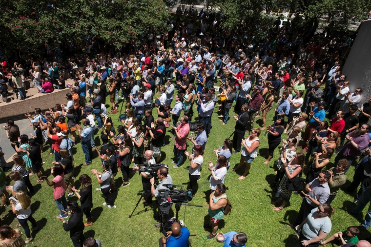 People gather to hold a faith vigil at Thanks-Giving Square in Dallas, Texas, on July 8, 2016, following the shootings during a peaceful protest on July 7 which left 5 police officers dead. (Laura Buckman/AFP/Getty Images)