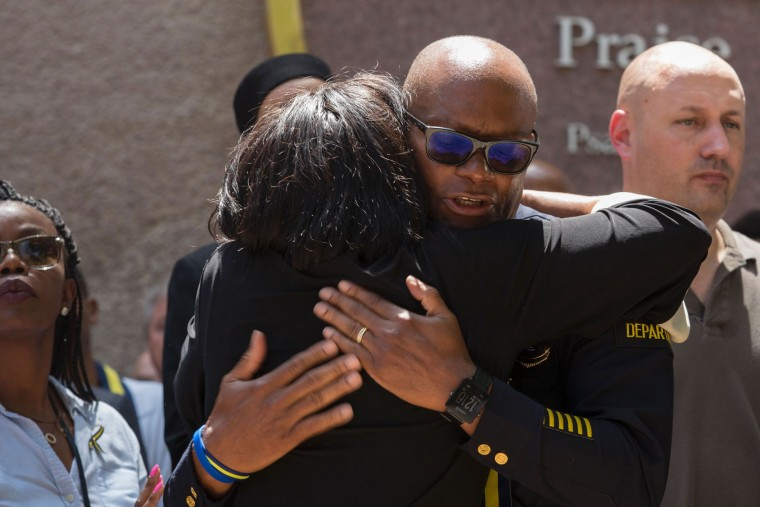 Dallas Police Chief David Brown receives a hug during a vigil in Thanks-Giving Square in Dallas, Texas, on July 8, 2016, following the shootings during a peaceful protest on July 7 which left 5 police officers dead. (Laura Buckman/AFP/Getty Images)