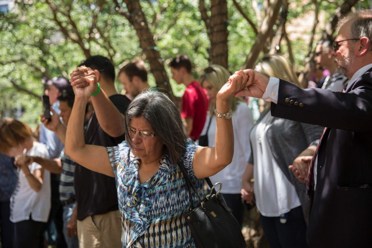 People pray at a faith vigil at Thanks-Giving Square in Dallas, Texas on July 8, 2016, following the shootings during a peaceful protest on July 7 which left 5 police officers dead. (Laura Buckman/AFP/Getty Images)