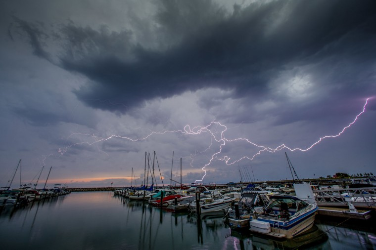 Lightning streaks across the sky over the marina Thursday, July, 21, 2006 in Port Washington, Wi. (AP Photo/Jeffrey Phelps)