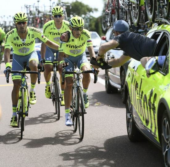 Spain's Alberto Contador gets a new shoe at his team car after crashing during the first stage of the Tour de France cycling race over 188 kilometers (116.8 miles) with start in Mont-Saint-Michel and finish in Utah Beach, France, Saturday, July 2, 2016. (Jerome Prevost, Pool via AP)