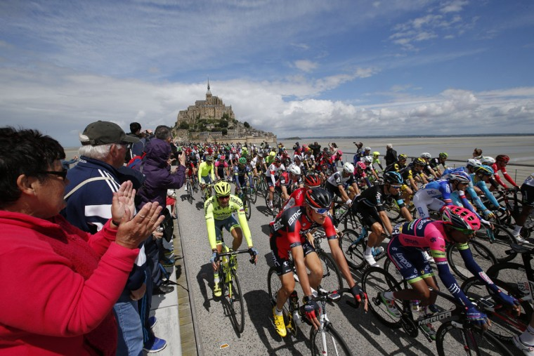 The pack with Tejay van Garderen of the U.S., second rider from left, takes the start at the Mont-Saint-Michel, rear, during the first stage of the Tour de France cycling race over 188 kilometers (116.8 miles) with start in Mont-Saint-Michel and finish in Utah Beach, France, Saturday, July 2, 2016. (AP Photo/Christophe Ena)