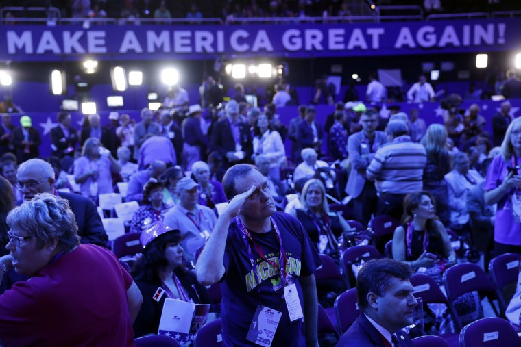 Bob Little from Warren Mich., salute as her observes a presentation during first day of the Republican National Convention in Cleveland, Monday, July 18, 2016. (AP Photo/Matt Rourke)