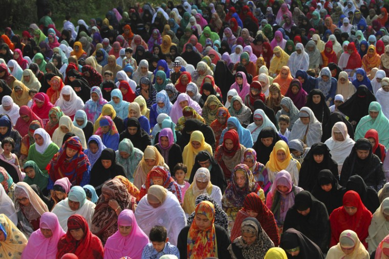 Kashmiri Muslim women offer Eid al-Fitr prayers in Srinagar, in Indian-controlled Kashmir, on Wednesday. (Mukhtar Khan/AP)