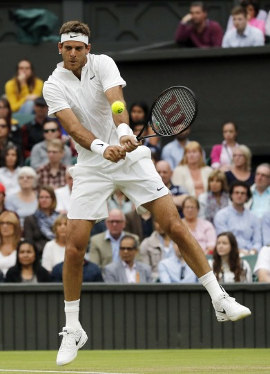 Juan Martin del Potro of Argentina returns to Stan Wawrinka of Switzerland during their men's singles match on day five of the Wimbledon Tennis Championships in London, Friday, July 1, 2016. (AP Photo/Ben Curtis)