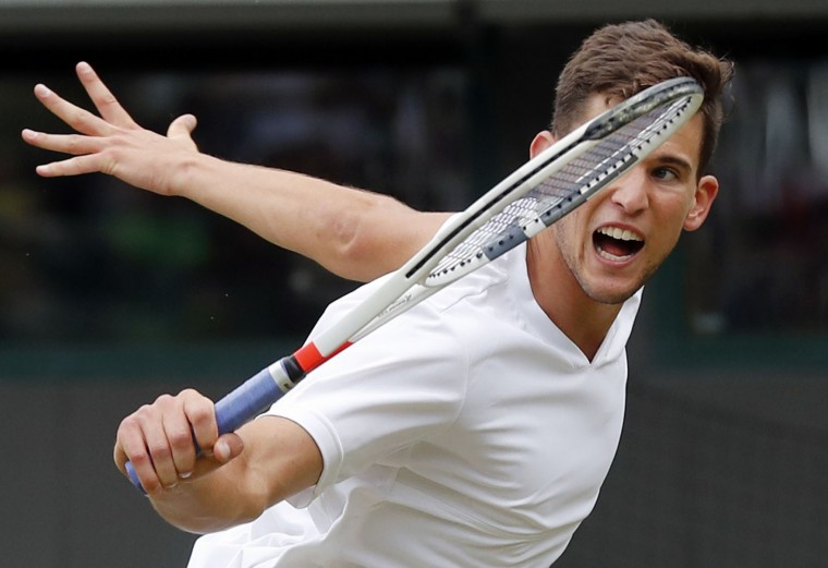 Dominic Thiem of Austria returns to Jiri Vesely of the Czech Republic during their men's singles match on day four of the Wimbledon Tennis Championships in London, Thursday, June 30, 2016. (AP Photo/Ben Curtis)