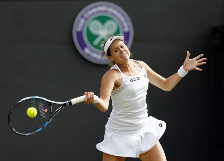 Jana Cepelova of Slovakia returns to Garbine Muguruza of Spain during their women's singles match on day four of the Wimbledon Tennis Championships in London, Thursday, June 30, 2016. (AP Photo/Ben Curtis)