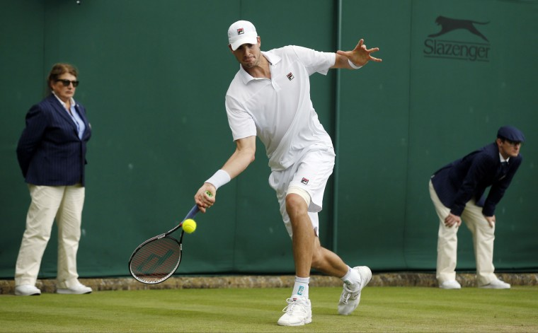 John Isner of the U.S plays a return during his men's singles match against Matthew Barton of Australia on day five of the Wimbledon Tennis Championships in London, Friday, July 1, 2016. (AP Photo/Alastair Grant)