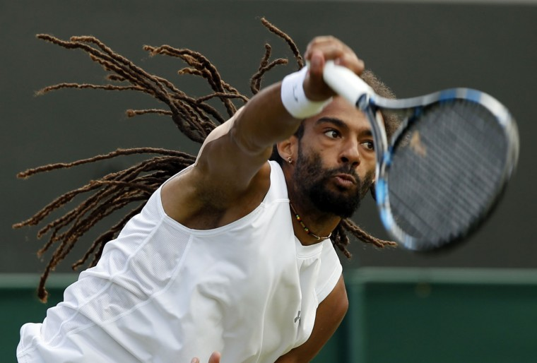 Dustin Brown of Germany serves to Nick Kyrgios of Australia during their men's singles match on day five of the Wimbledon Tennis Championships in London, Friday, July 1, 2016. (AP Photo/Alastair Grant)
