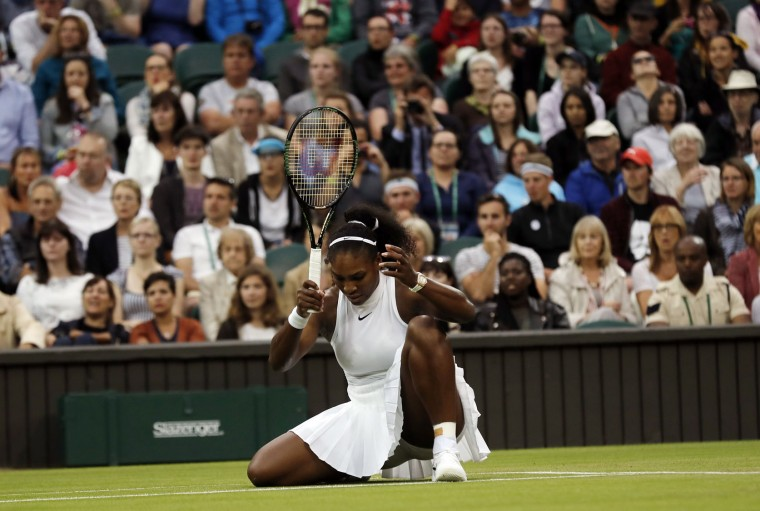 Serena Williams of the U.S slips playing Christina McHale of the U.S during their women's singles match on day five of the Wimbledon Tennis Championships in London, Friday, July 1, 2016. (AP Photo/Ben Curtis)