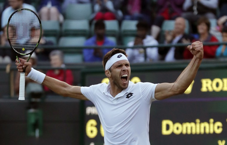 Jiri Vesely of the Czech Republic celebrates after beating Dominic Thiem of Austria in their men's singles match on day four of the Wimbledon Tennis Championships in London, Thursday, June 30, 2016. (AP Photo/Ben Curtis)