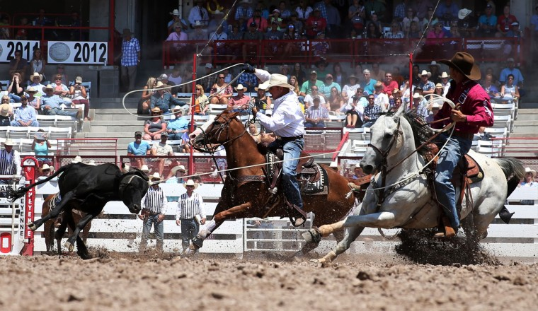 JoJo Lemond and Kory Koontz compete in the team roping event during the fifth day of the 120th annual Cheyenne Frontier Days Rodeo Wednesday, July 27, 2016, at Frontier Park Arena in Cheyenne, Wyo. (Blaine McCartney/The Wyoming Tribune Eagle via AP)