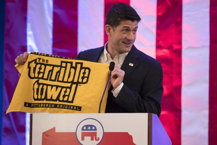 "Speaker of the House Rep. Paul Ryan, R-Wis., holds a ""Terrible Towel"" during a breakfast with Pennsylvania delegates during the Republican National Convention on, Monday, July 18, 2016, in Westlake, Ohio. (AP Photo/Evan Vucci)"