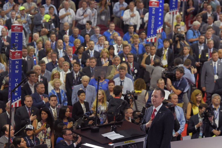 Reince Priebus, Chairman of the Republican National Committee listens to the Pledge of Allegiance during the opening day of the Republican National Convention in Cleveland, Monday, July 18, 2016. (AP Photo/Mark J. Terrill)