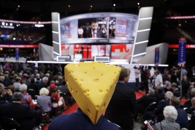 Barbara Finger from Oconto, Wis., wears a cheesehead hat during first day of the Republican National Convention in Cleveland, Monday, July 18, 2016. (AP Photo/John Locher)