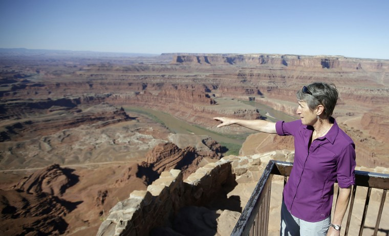 "U.S. Interior Secretary Sally Jewell looks from Dead Horse Point during a tour Thursday, July 14, 2016, near Moab, Utah. Jewell is visiting the area this week to meet with proponents and opponents the latest indication the Obama administration is giving serious consideration to the ""Bears Ears"" monument proposal. The issue has become the latest battleground in the debate over public lands in the West. (AP Photo/Rick Bowmer)"