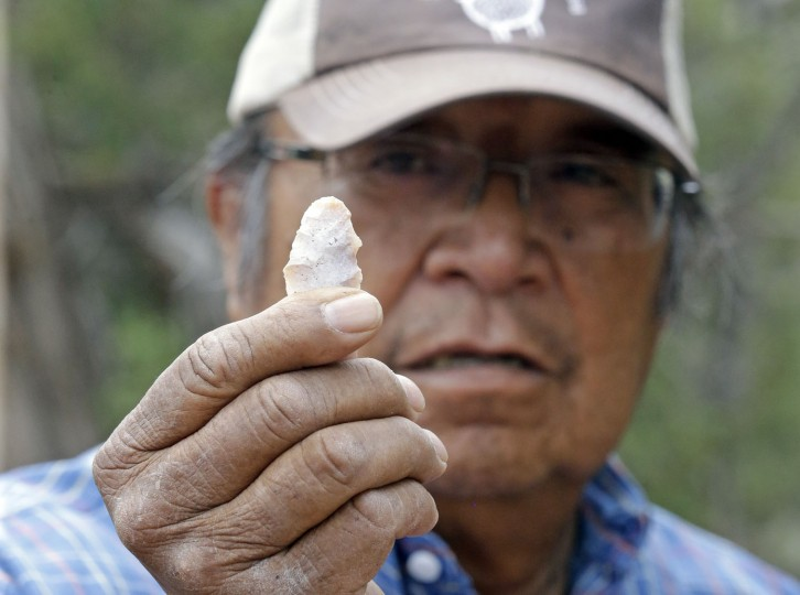 "This June 22, 2016, photo, Jonah Yellowman, a Navajo spiritual adviser holds a arrowhead found laying on the ground in Kane Gulch, near Blanding, Utah. Tribal members visit the ""Bears Ears"" land named for a set of rock formations to perform ceremonies, collect herbs for medicinal purposes and do healing rituals. (AP Photo/Rick Bowmer)"