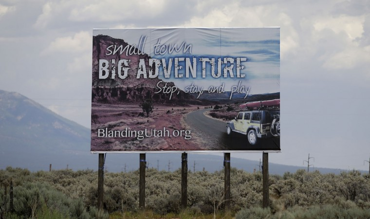 In this June 23, 2016, photo, a sign is shown near Blanding, Utah. Opponents of the monument designation agree that the area is a natural treasure worth preserving, but fear a federal designation would add more layers of restrictions and make it difficult for local residents and others to camp, bike, hike and gather wood on the land, while still not stopping people who want to do damage there. (AP Photo/Rick Bowmer)