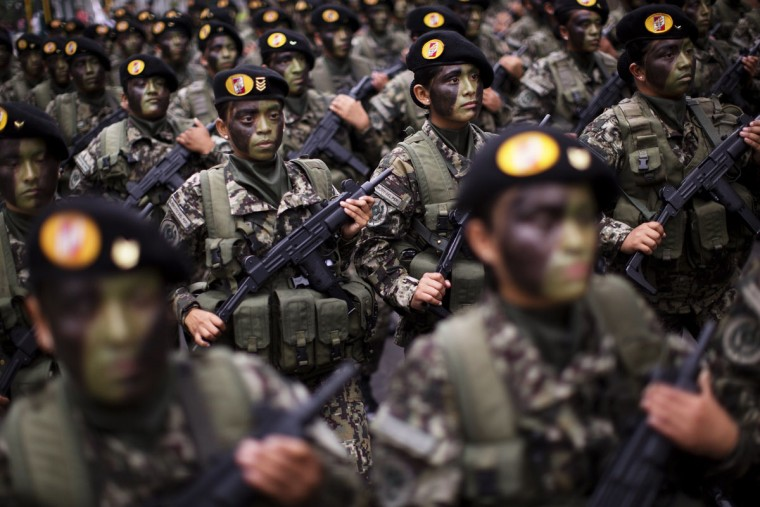 Soldiers march in a military parade marking the country's Independence Day in Lima, Peru, Friday, July 29, 2016. Peru declared it's independence from Spain on July 28, 1821. (AP Photo/Rodrigo Abd)