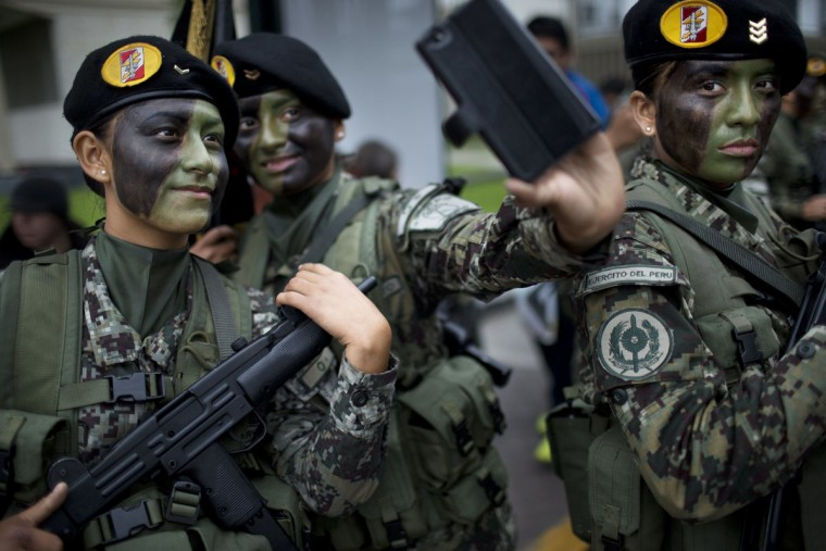 Soldiers pose for a selfie before the start of a military parade to mark the country's Independence Day in Lima, Peru, Friday, July 29, 2016. Peru declared it's independence from Spain on July 28, 1821. (AP Photo/Rodrigo Abd)