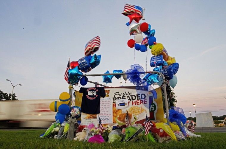 A makeshift memorial sits in front of the B-Quick convenience store in Baton Rouge, La., Tuesday, July 19, 2016, after law enforcement officers were killed on Sunday. (AP Photo/Max Becherer)