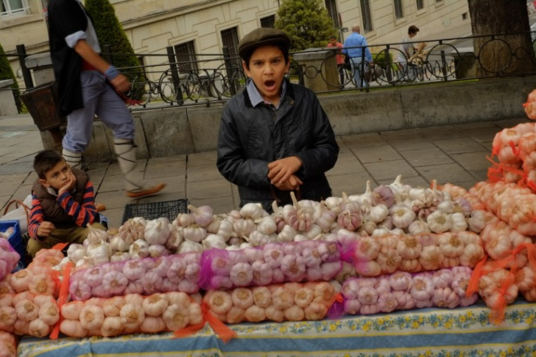 A young seller waits to sell strips of garlic during the garlic fair in Vitoria, northern Spain, on Monday. (Alvaro Barrientos/AP)