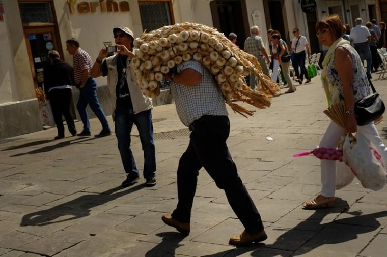 A man carries strips of garlic during the garlic fair in Vitoria, northern Spain, on Monday. (Alvaro Barrientos/AP)