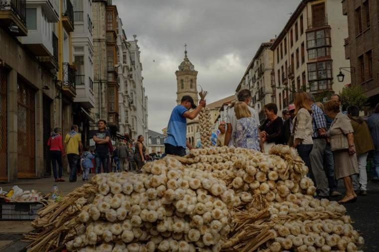 A seller prepares strips of garlic during the garlic fair in Vitoria, northern Spain, on Monday. (Alvaro Barrientos/AP)