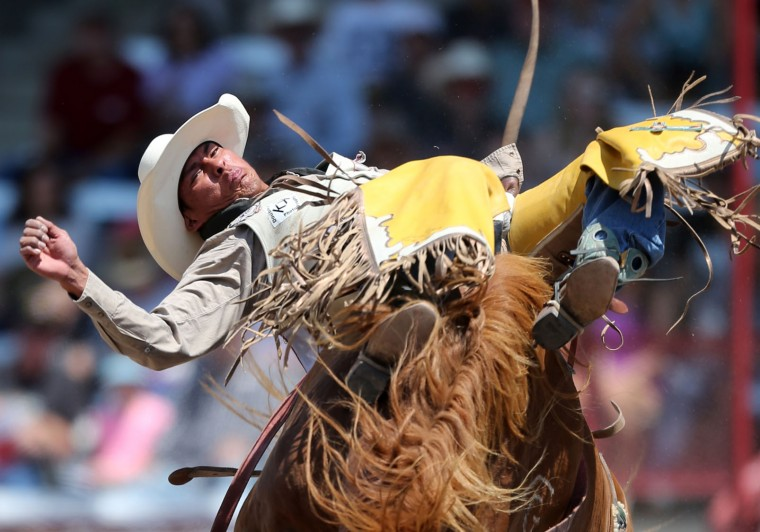Kyle Charley of Lukachukai, Ariz., competes in the bareback event during the fifth day of the 120th annual Cheyenne Frontier Days Rodeo Wednesday afternoon, July 27, 2016, at Frontier Park Arena in Cheyenne, Wyo. (Blaine McCartney/Wyoming Tribune Eagle via AP)