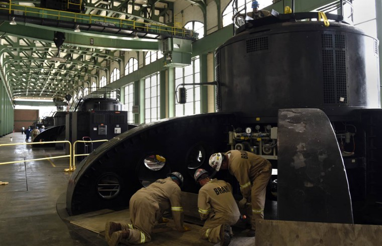 Workers inspect one of the turbines at the Exelon Conowingo Hydroelectric Plant, which has been producing electricity on the Susquehanna River since 1928. (Barbara Haddock Taylor, Baltimore Sun)