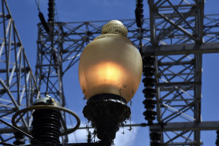 On the roof substation at the Exelon Conowingo Hydroelectric Plant, which has been producing electricity on the Susquehanna River since 1928, an original lamp post is lit, powered by electricity produced at the plant. (Barbara Haddock Taylor, Baltimore Sun)