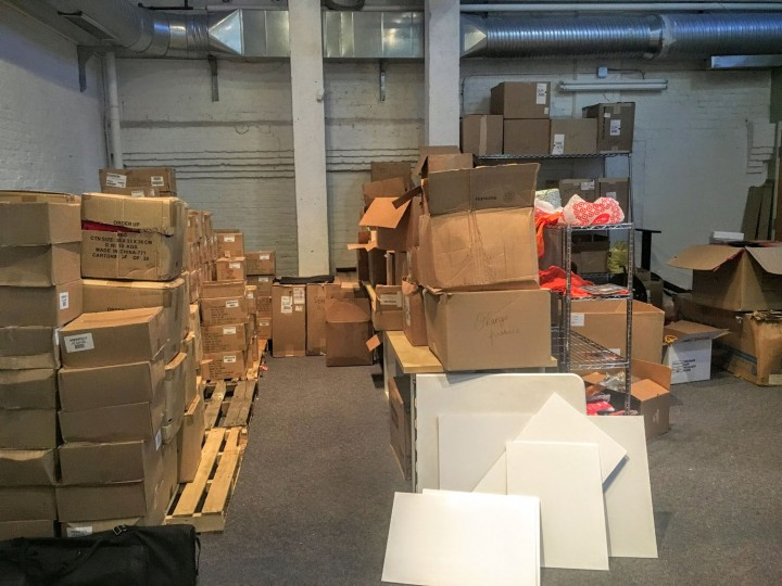 The job isn't always glamourous. I spend some time in the warehouse, sifting through boxes to find t-shirts, tumblers, and other swag for events.