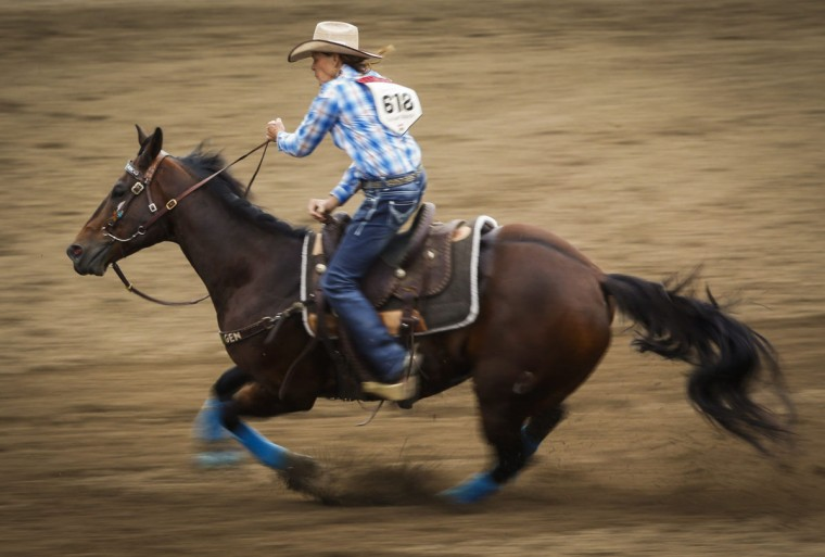 Mary Walker, from Ennis, Texas, competes in barrel racing at the Calgary Stampede in Calgary, Alberta, Saturday, July 9, 2016. (Jeff McIntosh/The Canadian Press via AP)