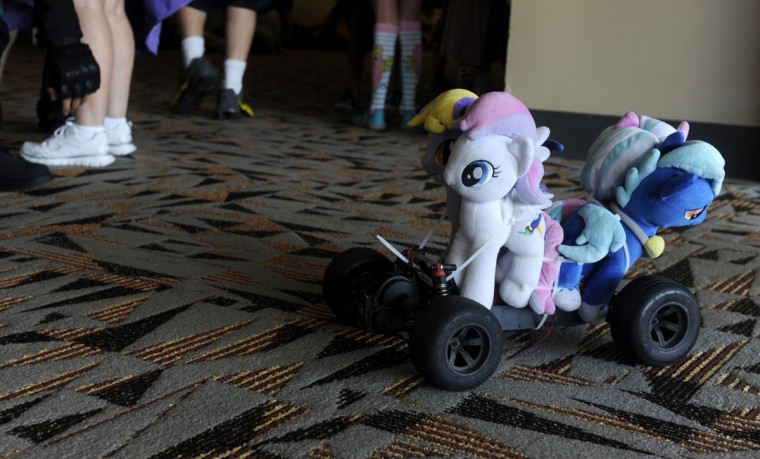 """Garrick Gorden of Omaha, Nebraska constructed a pony mobile. Pony plushies are tied to an RC car. """"People's reactions to it are pretty cool,"""" Gorden said. BronyCon is the world's largest My Little Pony: Friendship is Magic convention. Held at the Baltimore Convention Center, BronyCon features panels, meet-ups, activities, and cosplay. (Caitlin Faw/Baltimore Sun staff)"""