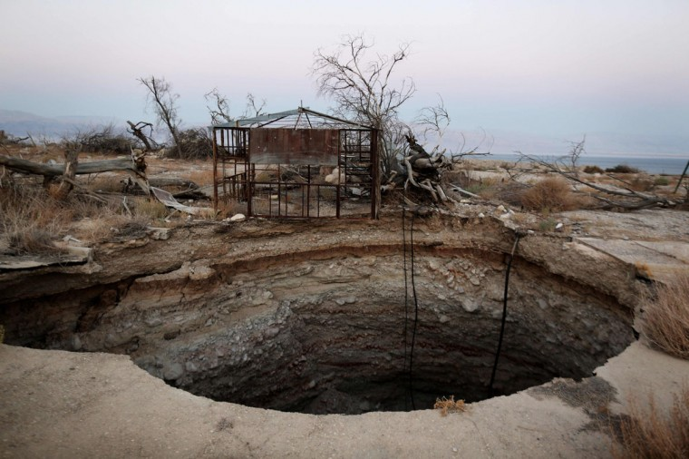 A general view shows a sinkhole in Israel's abandoned tourist resort of Ein Gedi on the shore of the Dead Sea on July 11, 2016. (MENAHEM KAHANA/AFP/Getty Images)