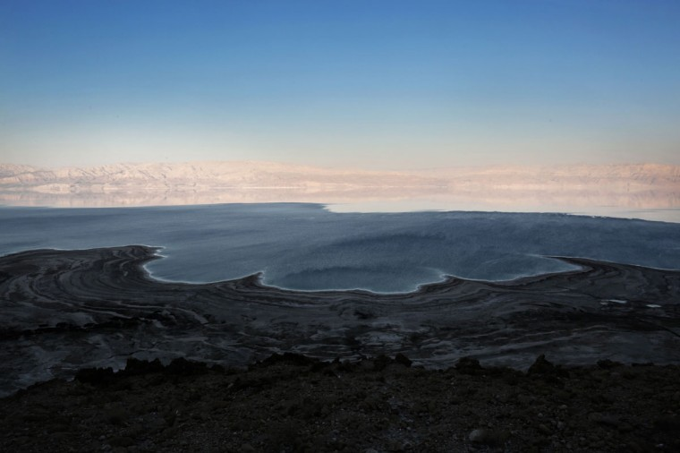 A general view taken from Israel shows the Dead Sea with the Jordanian mountains in the background on July 11, 2016. (MENAHEM KAHANA/AFP/Getty Images)
