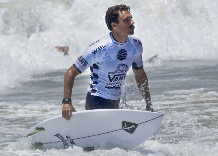Surfer Nate Yeomans emerges from the water after he takes second place in round two of the U.S. Open of Surfing competition on Tuesday, July 26, 2016 in Huntington Beach, Calif. (Mindy Schauer/The Orange County Register via AP)
