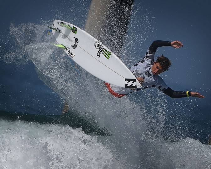 Griffin Colapinto of the US gets air before winning his men's heat during the first round of the US Open of Surfing at Huntington Beach, California on July 25, 2016. (MARK RALSTON/AFP/Getty Images)
