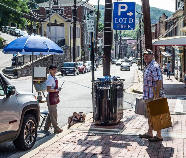 Plein air artists near the entrance to a public parking lot and the Firehouse Museum. (John Wisor/via Howard County Arts Council)
