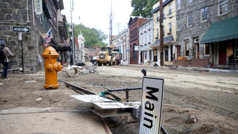 Flood damage toward the bottom of Main Street on Aug. 1. (Jen Rynda/Baltimore Sun Media Group)