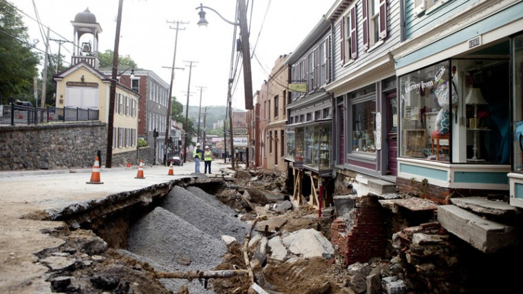 Road and sidewalk had totally given way in the 8200 block of Main Street. (Jen Rynda/Baltimore Sun Media Group)
