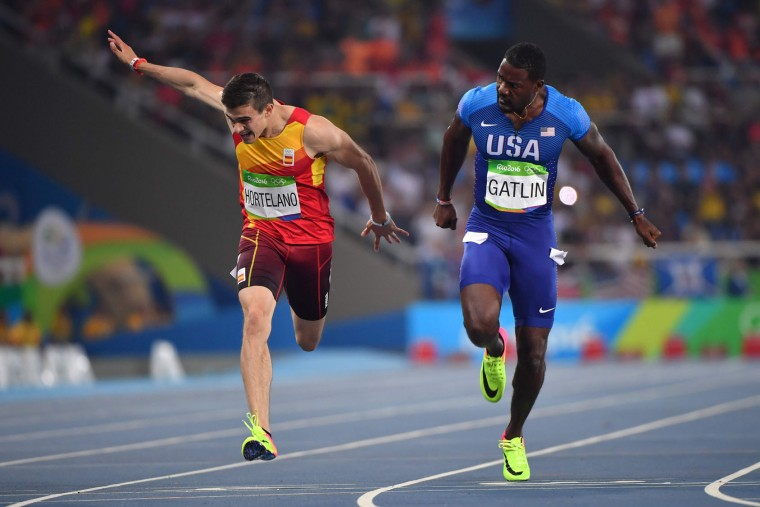 Spain's Bruno Hortelano (L) and USA's Justin Gatlin compete in the Men's 200m Semifinal during the athletics event at the Rio 2016 Olympic Games at the Olympic Stadium in Rio de Janeiro on August 17, 2016. (Olivier Morin/AFP/Getty Images)