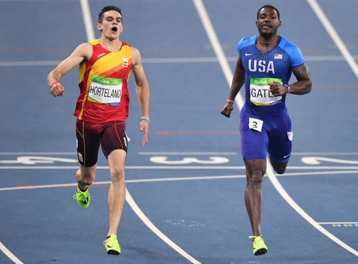 USA's Justin Gatlin (R) crosses the finish line ahead of Spain's Bruno Hortelano as they compete in the Men's 200m Semifinal during the athletics event at the Rio 2016 Olympic Games at the Olympic Stadium in Rio de Janeiro on August 17, 2016. (Pedro Ugarte/AFP/Getty Images)