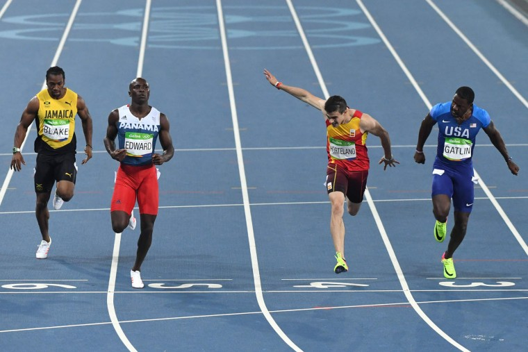 Panama's Alonso Edward (L) crosses the finish line ahead of USA's Justin Gatlin (R), Spain's Bruno Hortelano (2ndR) and Jamaica's Yohan Blake as they compete in the Men's 200m Semifinal during the athletics event at the Rio 2016 Olympic Games at the Olympic Stadium in Rio de Janeiro on August 17, 2016. (Pedro Ugarte/AFP/Getty Images)