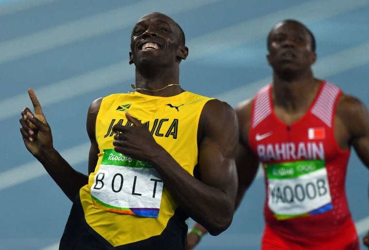 Jamaica's Usain Bolt celebrates his victory in the Men's 200m Semifinal during the athletics event at the Rio 2016 Olympic Games at the Olympic Stadium in Rio de Janeiro on August 17, 2016. (Jewel Samad/AFP/Getty Images)