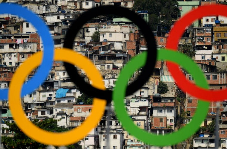 RIO DE JANEIRO, BRAZIL - AUGUST 09: The Olympic Rings seen in front of the favela Morro da Mineira on Day 4 of the Rio 2016 Olympic Games at the Sambodromo on August 9, 2016 in Rio de Janeiro, Brazil. (Photo by Matthias Hangst/Getty Images)