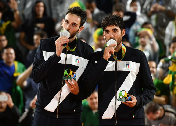 Italy's silver medallists Paolo Nicolai and Daniele Lupo celebrate on the podium at the end of the men's beach volleyball event at the Beach Volley Arena in Rio de Janeiro on August 19, 2016, during the Rio 2016 Olympic Games. (Leon Neal/AFP/Getty Images)